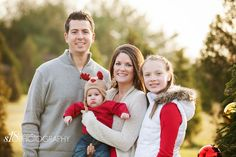 Not my photo. Light, neutral colors work well as long as they are not pastels. Whites, tans, grays work well, especially when a pop of red is combined with it. christmas tree farm photo sessions - Google Search