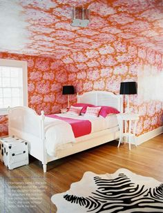 Great girls' bedroom by Angie Hranowsky, goin' nuts with that awesome hot pink and orange Manuel Canovas toile. And yes, I love it all the way up and over the ceiling.
