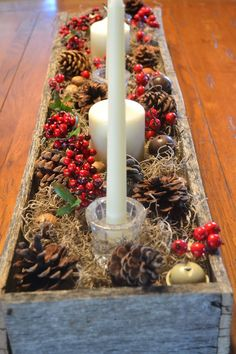 """You remember that box my husband made from an old pallet? Well, I removed the punkin's and added more pine cones, berries, bells, and candles. Now, our table is ready for Christmas! Yay! Sorry about the photo """"overkill""""….I finally got a new camera, and I'm trying to figure out how to run the darn thing."""