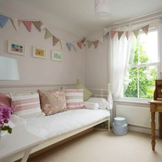 Shabby-chic living room Deck chair striped cushions are teamed with chintzy florals and polka dots for a charming summery look. A vintage-style day bed adds a relaxed feel, while pretty bunting harks back to traditional English fetes.