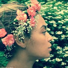Flower girl: The 34-year-old wore a handmade flower crown made out of pink carnations and ...
