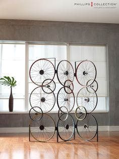 Our beautiful and unique Bicycle Collections is made of reclaimed bicycle parts. www.phillipscollection.com