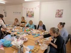 Students having fun at a cupcake decorating class from All Things Sugar.  Based in Warrington, Cheshire, All Things Sugar offer a range of cake decorating courses for all skill levels