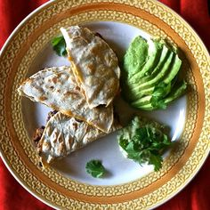 These cheesy pumpkin black bean quesadillas with jalapeño lime cream have the perfect amount of spice sweetness for an amazing appetizer. By Jessie Brown