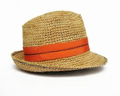 """If you're not in the mood for a statement beach chapeau this one is right  for you. This classic fedora in crochet raffia is the perfect go-to hat for  a lazy day at the shore. Lightweight and pliable, it stuffs easily into  your bag, and fears nor sand, salt or sun.The hatband is casually draped  around the crown and secured with free-form stitching through the middle to  give it a carefree attitude.      * Body: Raffia, Trim: Cotton, rayon     * One size: Medium 22 ¾"""" Crown height 4""""…"""