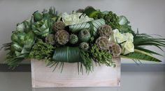 Masculine arrangement with scabiosa, poppy pods, kale, etc.
