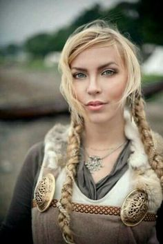 Lily has nordic features. Face shape and skin color would resemble this