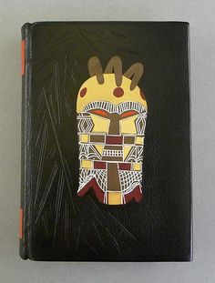 Binding by Patricia Burge. Heart of Darkness, London, 1997. Colours and design suggested by the subject. Full goatskin black leather binding with calfskin inlays and onlays and white tooling by stylus. Hand sewn headbands. Edge decoration with aniline die and watercolours. Internal joint and labels in scarlet goatskin.