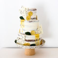 Semi-naked lemon, bay and black sesame drip wedding cake by Blossom & Crumb