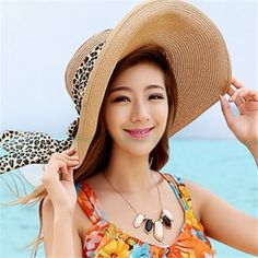 Wide brim straw sun hat with bow for ladies