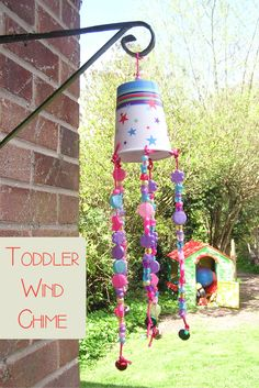 Simple wind chime to make with toddlers - produces a fairy bells sound with a slight breeze and great for developing fine motor skills as you create together