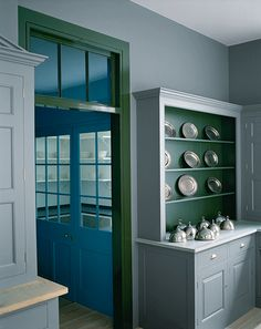 'The Spitalfields Kitchen' by Plain English with cupboards & walls painted in 'Draughty Passage'; dresser interior & doorframe painted in 'Army Camp'; larder doors painted in 'Scullery Latch'; larder painted in 'Boiled Dishcloth'.All paints from the 2013 colour collection by Adam Bray and Sue Skeen.