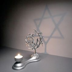 So pretty. Light the candle, and the tangled branches of the Tree of Life cast a perfect shadow of the Star of David. But how? The secret is in the positioning of each branch and the interaction of light and shadow. <-- Categorizing this in Dream house because I don't know where else to put it and anyway my future wife is Jewish.