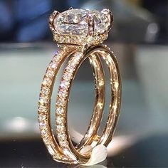 Beautiful engagement ring.  Cushion cut it seems and double ring.