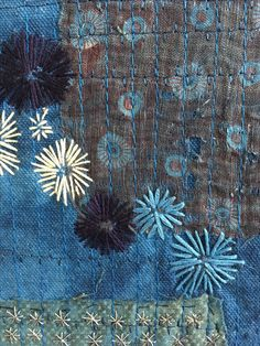 Detail of Astra. Hand stitching on vintage textile.