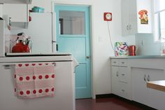 I LOVE the turquoise door! New idea for the door from the kitchen to the mud room Fun!