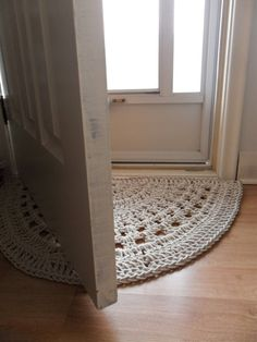 Half-moon shape crochet rug -- cream-coloured rope clothes line in a cotton / poly blend