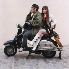 The Mod couple on the vehicle of choice. Any scooter would do, but a Vespa was THE statement.