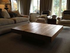 The beautiful pedestal coffee table from The Cool Wood Company