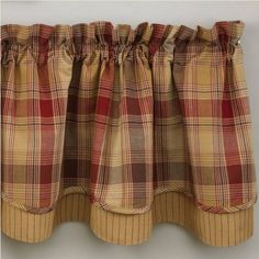 """Rich autumn hues of burgundy, rust and mustard combine in this pleasing plaid to create a feeling of warmth and comfort. The Hearthside Layered Lined Valance window curtain topper is created using two layers of coordinating fabrics. Designed to be gathered approximately one and a half times the width of your window. Use multiple panels for wider windows. Lined. 100% cotton. 72"""" Wide x 16"""" Long. Dry Clean for best results and to prevent shrinkage."""