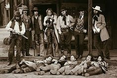 The Eagles are posing as the Dalton Gang captured and killed by Captain Jack for the back cover of their album, Desperado That is the history of this photo. The Eagles, Eagles Band, Eagles Lyrics, Dalton Gang, Wild West Outlaws, Westerns, Old West Photos, Morrison Hotel, Glenn Frey