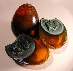 Century Eggs, also known as Preserved Egg or Thousand-Year Egg, is considered a delicacy in China. They are prepared by taking fresh duck, chicken or quail eggs and preserving them for several weeks in a mixture of clay, ash, salt, lime, and rice. No thanks.