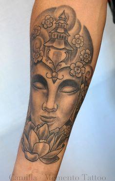 Healed black and grey Buddah tattoo.