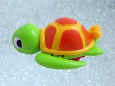"Swimming Turtle Floating Bathtub Bath Toy for kids by Bathtub Toys. $5.95. Measures 5"" long. Great for bathtime fun!. Swims in water and crawls on land. Cute turtle swims and floats in water. Moves using pull cord funtion. Cute swimming turtle!   Make bath time more enjoyable with this fun filled swimming turtle.  This turtle swims and floats in water.  To make this turtle swim, pull back the baby turtle.  The attached cord extends 4"".  When you release the baby turt..."