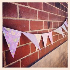 Hand made bunting - scrap booking paper, string & sticky tape!