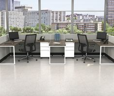 Low partition walls create an open feel for an open concept and promoting collaboration, while still allowing a semi private workspace. Featured: Office Star Products SIS paneling.