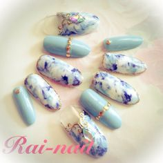 Sky blue nail with blue and white marble accent nails