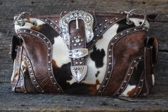 I checked out Rhinestone Cow Print Purse on Lish, You can also check this out at D & D Western Wear on Facebook $45.00 USD