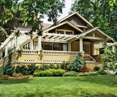 The combination of golden bricks and dark brown cedar shakes makes this bungalow stand out. The colors of the brickwork with the white trim and pergola provide an eye-catching departure from the surrounding greenery Craftsman Bungalow Exterior, Bungalow Homes, Ranch Style Homes, Craftsman Bungalows, Craftsman Style, Front Porch Pergola, Small Front Porches, Porch Railings, Front Porch Addition