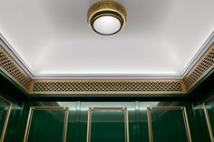 Private Women's Club of Chicago Restoration by Craig and Company feature a Lustrous Elevator Transformation and Traditional Elevator Cab Ceiling