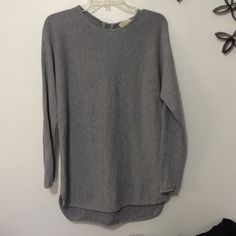 Michael Kors Sweater Great condition. No major flaws. Worn twice. Has zipper on back. It's a long sweater. I'm 5'9 so I guess if you're a bit shorter it could be a sweater dress.  Feel free to ask questions. Michael Kors Sweaters Crew & Scoop Necks