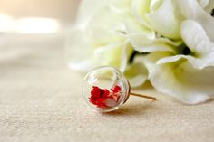 ALOTSS - -----------------------------------------------------------------------  Size: 14mm (diameter)  Materials: Glass Orb / Real Dried Flower /