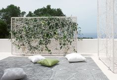 Designed by DEDON, this wiremesh green wall creates an oasis with this multi-faceted room divider and define private, undisturbed spaces for breezy relaxation. Description from blog.miragestudio7.com. I searched for this on bing.com/images