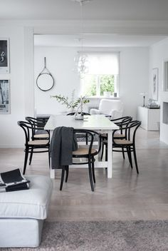 Black bentwood chairs around white dining table via House of Philia House Of Philia, Dining Room Inspiration, Interior Design Inspiration, Bentwood Chairs, Dining Chairs, Dining Area, White Dining Table, Adirondack Chairs For Sale, Decoration Originale