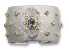 A multi-coloured sapphire and diamond cuff, by Buccellati