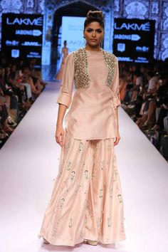 blush silkmul kurta with roll-up sleeves paired with matching butti embroidered sharara pants with tassel detailing. by Payal Singhal.