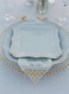 vintage china, wedding event planner bought vintage handerchiefs and screen printed names of the guests on them for place card effect