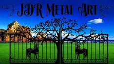 Wrought iron scrolls on tree & horse themed driveway gate designed by JDR Metal Art.