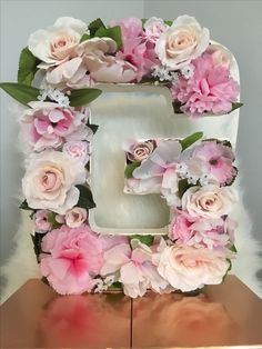 DIY Floral Letters Super easy: cardboard letters, dry oasis or styrofoam, fake flowers, fake greens, and some hot glue! #G #wedding #spring #decor #craft #pink #project #gorgeous #stunning #love #beautiful #easy #diy #room #mantle #elegant #weddingshower #lovely #hotglue #flowerletters #floral #teen #girly #gift #michaels #joanns #cute #crafty #pretty #green