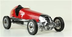 """BB Korn Red Tether Car The original """"Indianapolis"""" B B Korn Spindizzy was sold by the B. B. Korn Specialty Mfg Co of Los Angeles, California. Pre-war aluminum car (assembled) sold for $49.50, the magnesium car (assembled) sold for $53.50. This BB Korn Tether car was considered the """"premium"""" of the toy speed cars. Technically skilled enthusiasts of the 1930s loved to race the legendary B.B. Korn cars around the club tracks. Called tether cars or spindizzies, they reached incredible speeds…"""