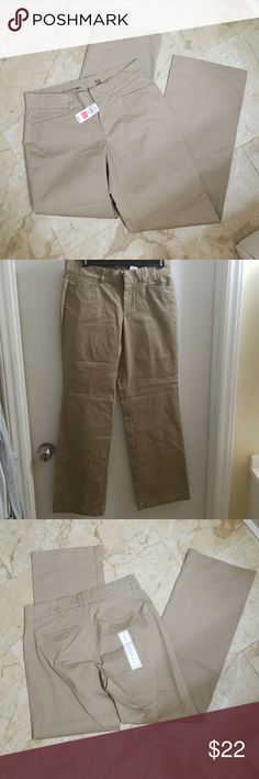 Women's Dockers size 6 NWT Dockers khaki pants size 6 NWT.  Cotton blend material, straight leg cut. Thank you for shopping my closet.  All items come from a smoke free, Pet friendly home.  Everything listed has been thoroughly inspected for any imperfections.   Please feel free to ask any questions you may have.  Happy Poshing! Dockers Pants Trousers