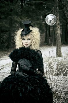 lolita in black little top hat with veil, black feather fan, black feather dress