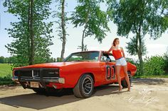 """Elli as Daisy Duke for the """"Girls & legendary US-Cars"""" 2016 calendar by SWAY Books. / Pic & retouch: www.carloskella.de / Model: Elisabeth Hornickel / H&MU: Tini Sager / Car: Dodge Charger """"General Lee"""", 1969 /Thanks to Motoraver Verlag & Yvonne Schmidt / Published by SWAY Books / www.sway-books.de 13 Wochen"""