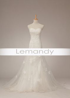 strapless sweetheart mermaid tulle with applique wedding gown lace-up back. $238.00, via Etsy.
