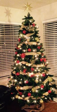 Burlap wrapped Christmas tree! Red and gold decorations. Country.