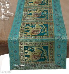 Table Runner Colorful Brocade & Poly Satin Table Runners Fabric: Poly Satin Size: Dimension (L X B) - 60 in X 16 in Description: It Has 1 Piece of Table Runner Work: Brocade Patch Work Sizes Available: Free Size *Proof of Safe Delivery! Click to know on Safety Standards of Delivery Partners- https://ltl.sh/y_nZrAV3  Catalog Rating: ★4.5 (260)  Catalog Name: Elegant Designer Poly Satin Table Runners Vol 2 CatalogID_92922 C129-SC1127 Code: 534-808546-
